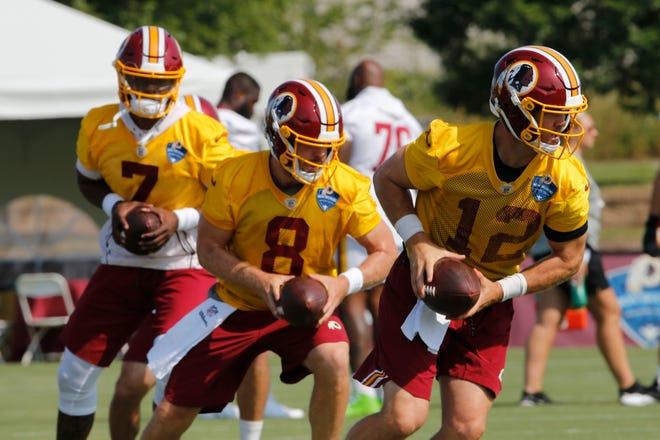 Washington Redskins quarterbacks Colt McCoy (12), Case Keenum (8) and Dwayne Haskins Jr., (7) run drills during NFL football training camp in Richmond, Va., Friday, July 26, 2019. (AP Photo/Steve Helber)