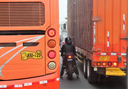 You make your own lane on congested  Peruvian roads, even squeezing between a bus and a truck.