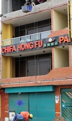 There is no shortage of Chinese food restaurants in the Lima, Peru, area, all starting with Chifa (China) followed by a more unique name. Buckets of sand were being raised and lowered for a fourth-floor building project here.