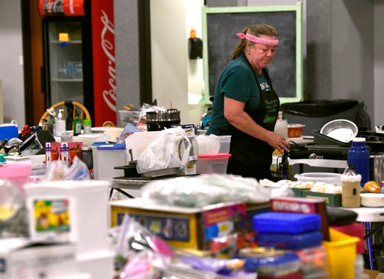 Christine Brockman sorts and organizes items in the First Christian Church activity building Aug/ 9. The church is holding a two-day sale beginning August 24 after selling the property to First Baptist Church in May.