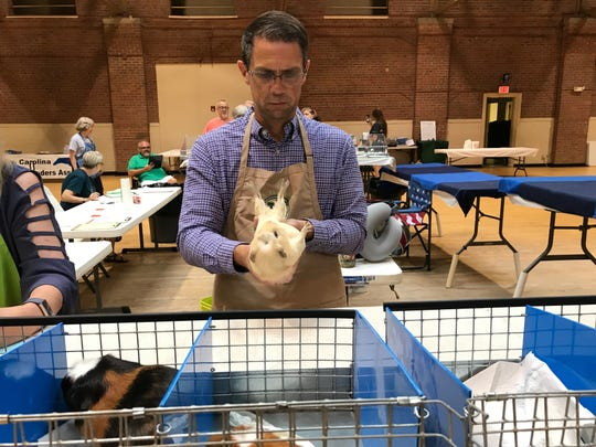 "Jason Whitehurst examines this cavy's underbelly. ""I enjoy finding that really spectacular animal in every show,"" he said."