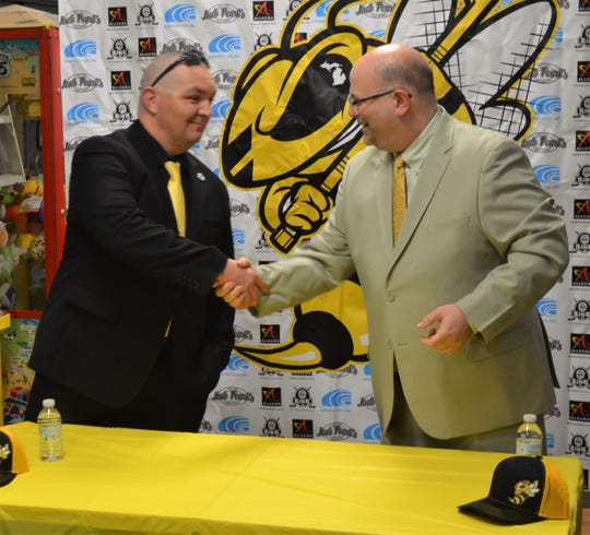 Battle Creek Rumble Bees General Manager Adam Stio, right, welcomes its first head coach Clint Hagmaier to town at a press conference at The Rink on Wednesday.