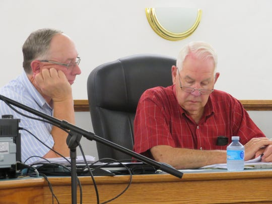 Town of Sanford Supervisor Dewey Decker, right, and Town Board member Edwin Ditewig exaimine documents at the Aug. 13 board meeting.
