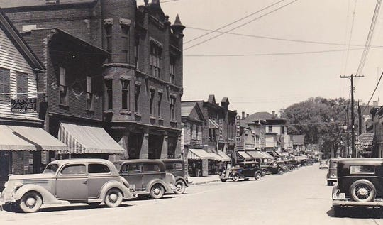 Front Street in Deposit, with the Farmer's National Bank in the brick building on the left.
