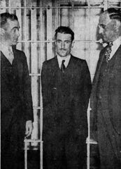 The arrest of James Archer, center, with Sheriff Arlington Thatcher, left, and Assistant District Attorney Donald Kramer.