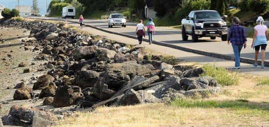 Pedestrians travel along the path along Bay Street in Port Orchard on Aug. 14, 2019. Plans to build a new segment of the path have drawn ire from business owners in Annapolis.