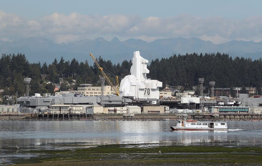The USS Carl Vinson is covered in white plastic while undergoing work at Puget Sound Naval Shipyard in August 2019.