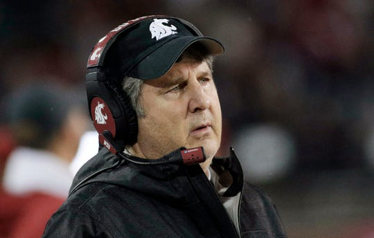 Washington State head coach Mike Leach watches during the second half of an NCAA college football game against California in Pullman, Wash. There's a good chance Washington State coach Mike Leach will once again turn the Cougars' Air Raid offense over to a graduate transfer quarterback.