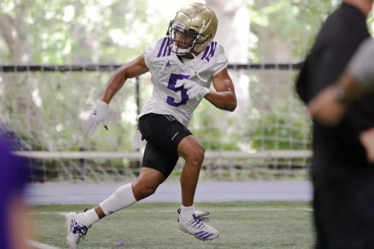 Washington's Myles Bryant runs through a drill during August practice in Seattle. Gone are four-year starting quarterback Jake Browning and his backfield mate Myles Gaskin, the school's all-time leading rusher. Gone are four starters from the secondary and the national leader in tackles. Myles Bryant is the one returning starter from the secondary, and is likely to play safety.