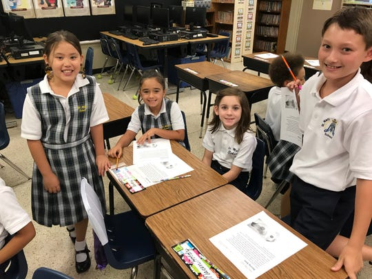 Students at St. Mary Catholic School begin their first day of the new school year.