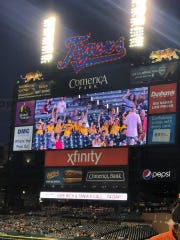 Players on the Viera Suntree Little League team, competing in Taylor, Mich., are shown on the Jumbotron at Comerica Park as they got to see a Detroit Tigers-Seattle Mariners game Tuesday night.