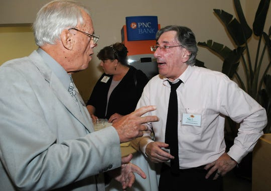 Terry Maguire and Neil Levine mingle at the 2014 Indiafest Sponsor dinner at Florida Tech's Panther Cafe.