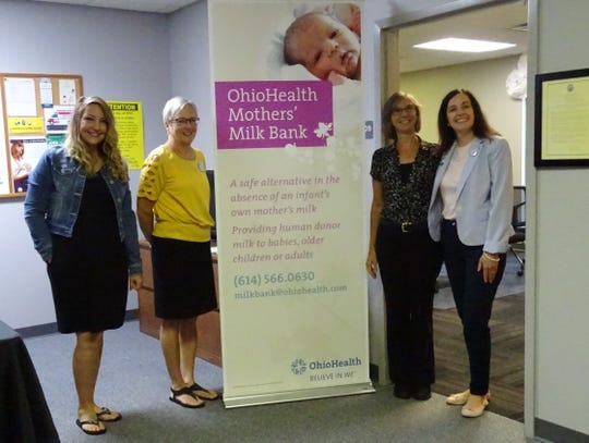From left, Holly Kozinski, breast feeding peer; Kathy Bushey, WIC director; Deanna Grube, lactation consultant; and Jennifer Foster of the OhioHealth Mothers' Milk Bank celebrate the opening of a milk drop-off site at Crawford County Public Health's WIC office on Wednesday.