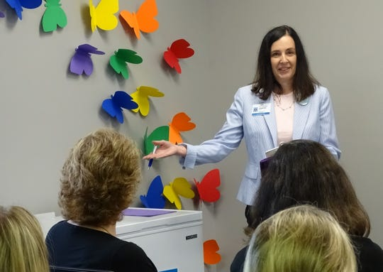 Jennifer Foster of the OhioHealth Mothers' Milk Bank speaks during the opening of a milk drop-off site at Crawford County Public Health's WIC office on Wednesday.