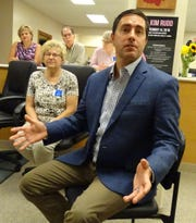 Ohio Secretary of State Frank LaRose speaks during a visit to the Crawford County Board of Elections office on Wednesday. Board director Ruth Leuthold is as left.
