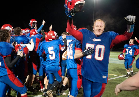 Hartford celebrates their 35-27 win over BFA St. Albans at the Div. I Football Vermont State Championship game at South Burlington High School on Saturday Nov. 10, 2012.