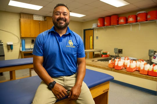 """Odem athletic trainer CJ """"Doc"""" DeLaGarza poses for a photo on Tuesday, Aug. 13, 2019."""