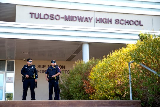Law enforcement officials stand outside Tuloso-Midway High School on Wednesday, August 14, 2019, following a threat of a school shooting that was made the night before online. In addition to a law enforcement presence, students were entering the school at one entrance, were having their backpacks checked and had auxiliary personal stationed around the school as extra eyes.