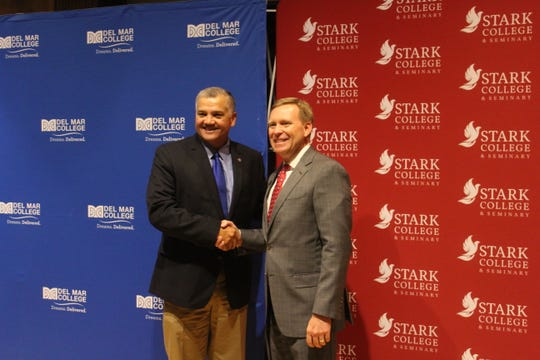 Del Mar College President Mark Escamilla, left, shakes hands with Stark College & Seminary President Tony Celelli during a press conference on Wednesday, Aug. 14, 2019. The two colleges entered an agreement to make it easier for Del Mar students to transfer general education credits to Stark College & Seminary.