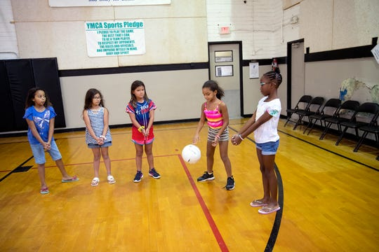 Girls play a game while participating in the YMCA summer camp on Wednesday, August 14, 2019. The summer camp is popular because it is a rare summer camp that stays open until just before school starts.