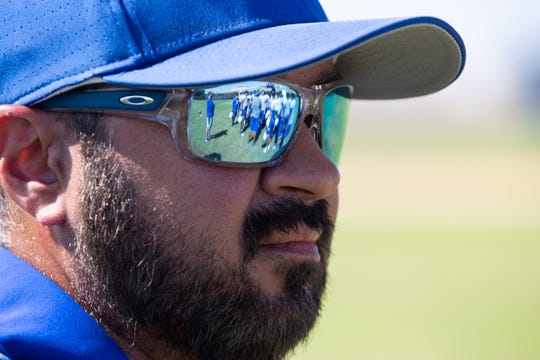 """Odem athletic trainer CJ """"Doc"""" DeLaGarza watches football practice from the side of the Odem High School practice field on Tuesday, Aug. 13, 2019."""