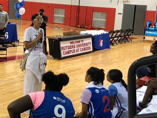 Valerie Still talks to girls at the 76ers' HoopHers summer camp program at Rutgers-Camden's gym.