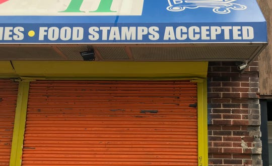 Authorities say  the federal government lost hundreds of thousands of dollars to a ring that defrauded the food-stamps program.