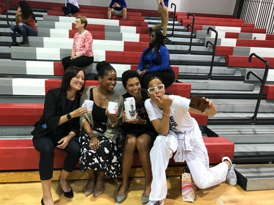 Valerie Still (right) takes a selfie with (left to right) Amy Hever of the Sixers Youth Foundation and Nyeema Watson and Phoebe Haddon of Rutgers University-Camden.