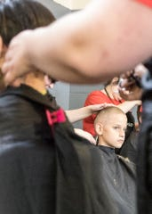 Brayden Pettiford, 8, gets his haircut done for free by a volunteer from Hair Mechanix Salon and Day Spa at the Salvation Army during its annual School Tools event on Tuesday, August 13, 2019. The yearly project started almost 20 years ago and helps provide local families and kids with school supplies, haircuts, and activities before the start of school.