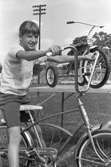 Janet Ringwald, 11, daughter of Mr. and Mrs. Don Ringwald, tries out her new bike during the Gazette-Jaycees bike races held in October 1969.