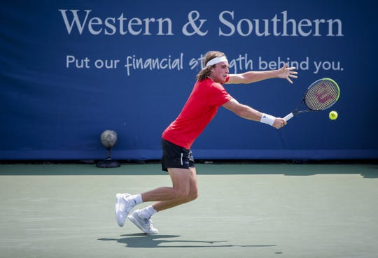 Stefanos Tsitsipas of Greece returns a shot from Jan-Lennard Struff of Germany on the Grandstand Court at the Western & Southern Open Wednesday, August 14, 2019 in Mason, Ohio. Struff advanced in three sets.