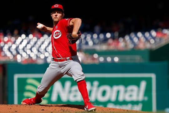 Aug 14, 2019; Washington, DC, USA; Cincinnati Reds starting pitcher Trevor Bauer (27) pitches against the Washington Nationals in the first inning at Nationals Park.