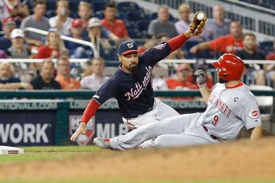 Aug 13, 2019; Washington, DC, USA; Cincinnati Reds second baseman Jose Peraza (9) is tagged out at third base by Washington Nationals third baseman Anthony Rendon (6) in the sixth inning at Nationals Park. The Nationals won 3-1. Mandatory Credit: Geoff Burke-USA TODAY Sports