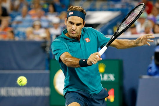 Roger Federer returns a shot in the second set during the Western & Southern Open match between Roger Federer and Juan Ignacio Londero at the Lindner Family Tennis Center in Mason, Ohio, on Tuesday, Aug. 13, 2019. Federer won in straight sets, 6-3, 6-4.
