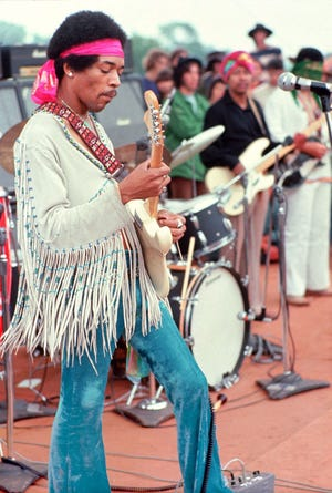 """Guitarist Jimi Hendrix delivered an unforgettable """"Star Spangled Banner"""" at Woodstock in 1969."""