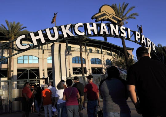 This Sept. 18, 2015 photo shows fans arrive at Chukchansi Park in Fresno, Calif., for a minor-league baseball game between the Fresno Grizzlies and the Round Rock Express. Fresno authorities say a man died shortly after competing in a taco-eating contest at a Grizzlies game.