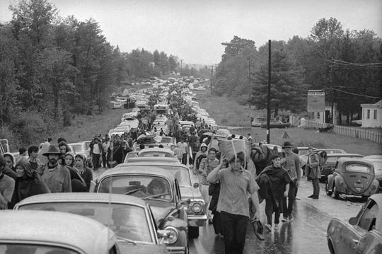 Hundreds of rock music fans jam highway leading from Bethel, New York, Aug. 16, 1969 as they try to leave the Woodstock Music and Art Festival. Two hundred thousand persons spent a rainy night at the festival.