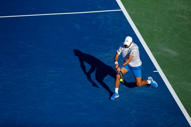Novak Djokovic returns a shot in the second set during the Western & Southern Open match between Novak Djokovic and Sam Querrey at the Lindner Family Tennis Center in Mason, Ohio, on Tuesday, Aug. 13, 2019. Djokovic advanced in straight sets, 7-5, 6-1.