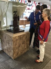 Elizabeth Black, Montgomery County administrator of elections, admires the production maquette of Tennessee Triumph with statue steering committee members Khandra Smalley and Rosalind Kurita. The maquette is currently housed in the Election Commission suite in Veterans Plaza.
