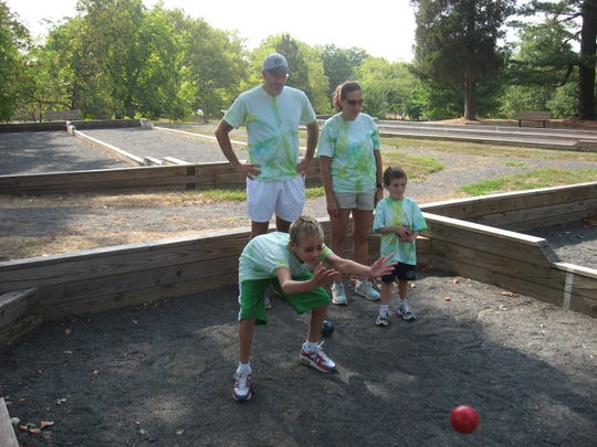 A family team plays bocce as part of the County Caper.