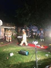 Three people escaped injury early Wednesday morning when a dump truck crashed into the front of a home in South Brunswick.