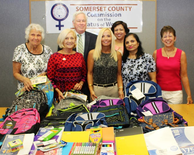 Schools supplies collected through Project First Class were presented by the Somerset County Commission on the Status of Women to Food Bank Network of Somerset County Executive Director Marie Scannell (left)and Feeding Hands Inc. Executive Director and Founder Lois Bennett (right). Also pictured, (front row left to right)are Freeholder Deputy Director Pat Walsh, Commission Chair Janice M. Fields and Commissioner Smriti Agrawal; and (back row)County Library Administrator Brian Auger and Commission Vice Chair Vaseem Firdaus.