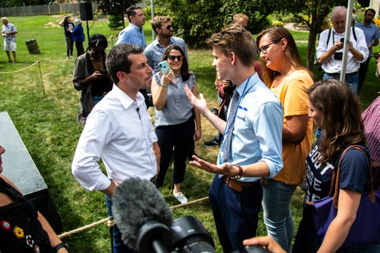 Democratic presidential candidate Pete Buttigieg, mayor of South Bend, Indiana, talks with Nick Roberts, 19, of Indianapolis, at a campaign event, Wednesday, Aug. 14, 2019, at a home in Muscatine, Iowa. Roberts drove ten hours from Indiana to see Buttigieg, on his 19th birthday.