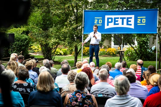 Democratic presidential candidate Pete Buttigieg, mayor of South Bend, Indiana, speaks at a campaign event, Wednesday, Aug. 14, 2019, at a home in Muscatine, Iowa.