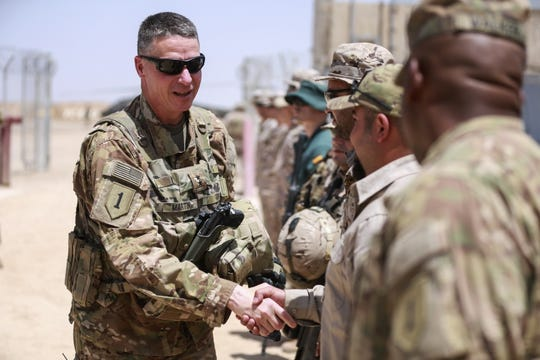 U.S. Army Maj. Gen. Joseph M. Martin  shakes hands with soldiers and members of the crew who finished the first phase of construction at the Besmaya Range Complex, Iraq, May 10, 2017.