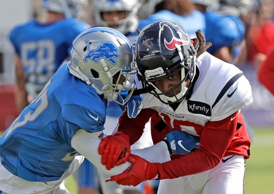 Texans wide receiver DeAndre Hopkins works against Lions cornerback Darius Slay during joint training camp football practice with the Houston Texans on Wednesday, Aug. 14, 2019, in Houston.