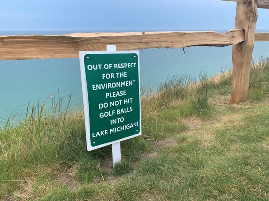 A new sign at Arcadia Bluffs Golf Club's 12th tee, overlooking Lake Michigan, encourages golfers not to hit balls into the Great Lake.
