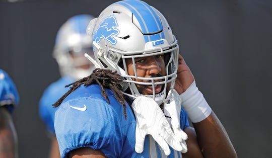 Lions linebacker Jalen Reeves-Maybin wears his gloves on his helmet during joint training camp football practice with the Houston Texans on Wednesday, Aug. 14, 2019, in Houston.