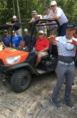 Dan Rooney, right, talks with Jack Nicklaus, behind the wheel, and others about the shaping of a par 4 hole at American Dunes in Grand Haven on Tuesday, Aug. 13, 2019.