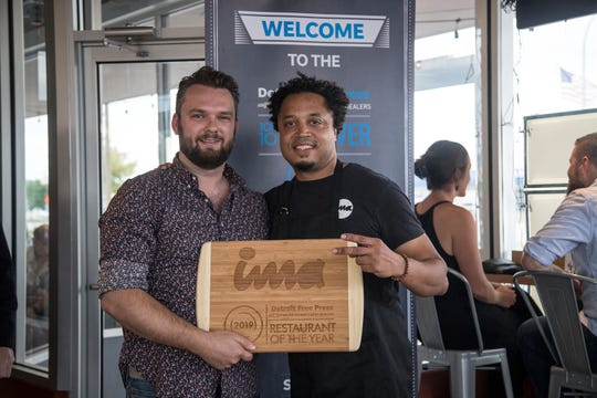 Free Press restaurant critic Mark Kurlyandchik presents Michael Ransom, the owner-chef of ima an award during the Detroit Free Press/ Metro Detroit Chevy Dealers Top 10 Takeover of ima in Madison Heights, Tuesday, August 13, 2019.